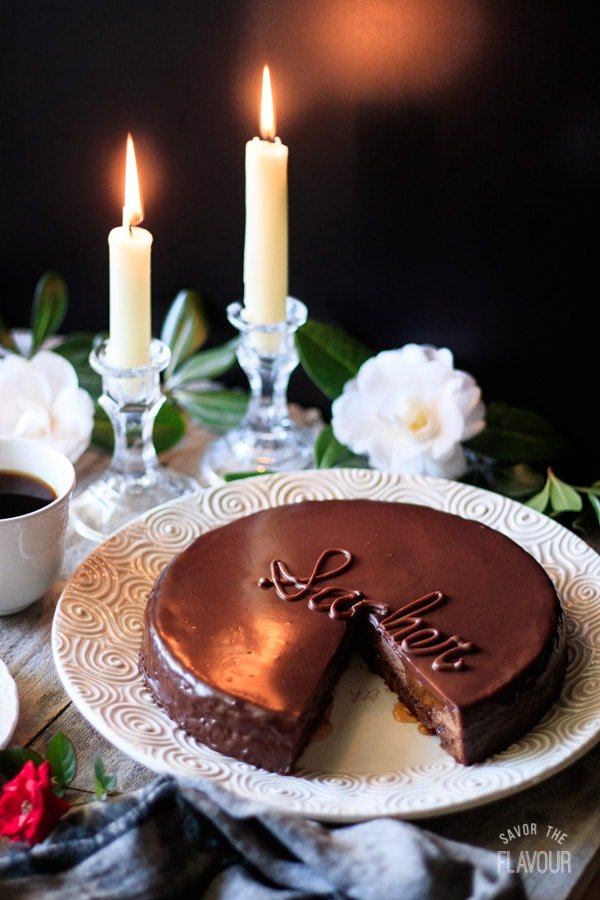 sachertorte with candles and flowers
