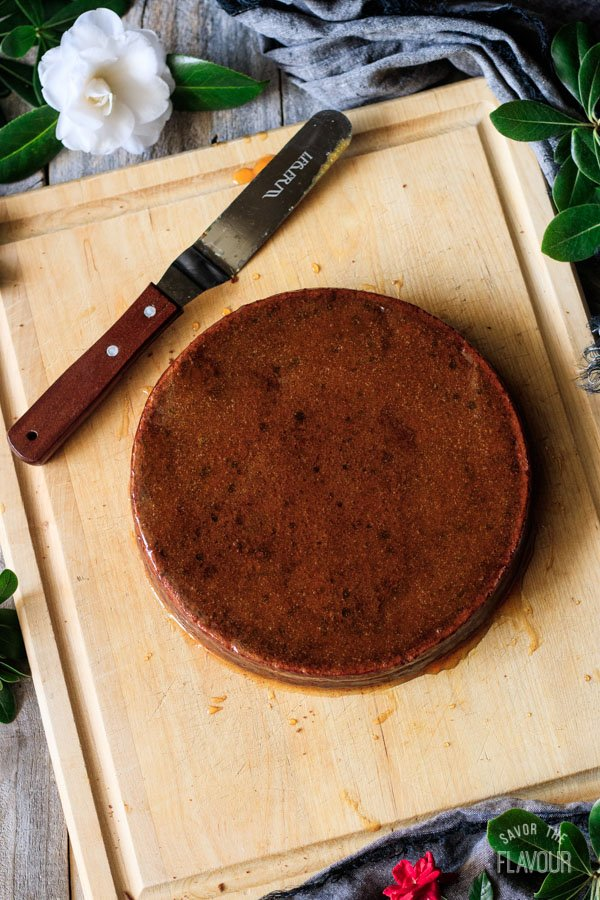 glazing the sachertorte with apricot glaze