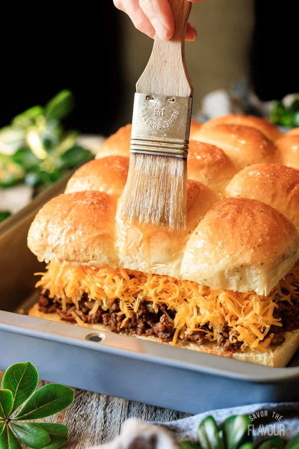 brushing butter on sloppy joe sliders