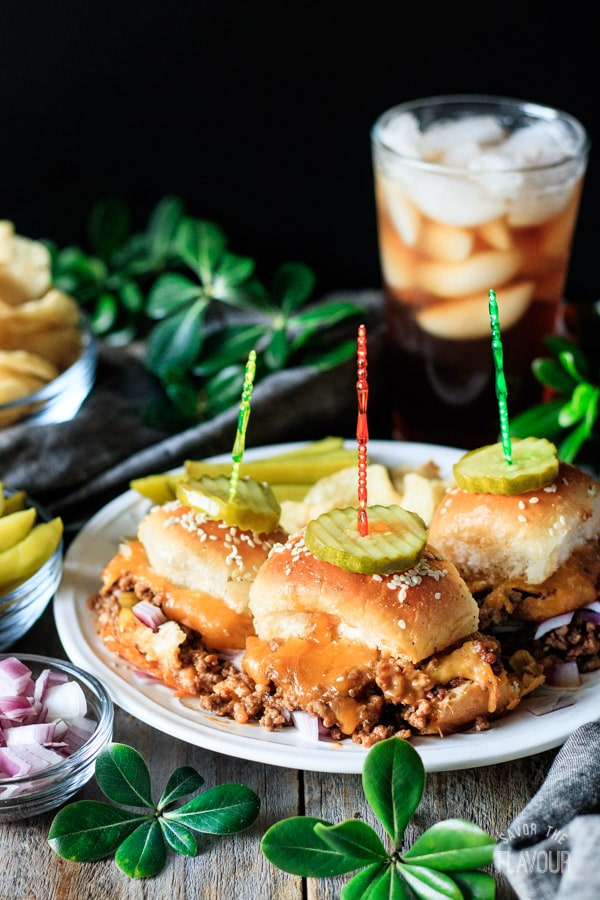 three sloppy joe sliders on a plate