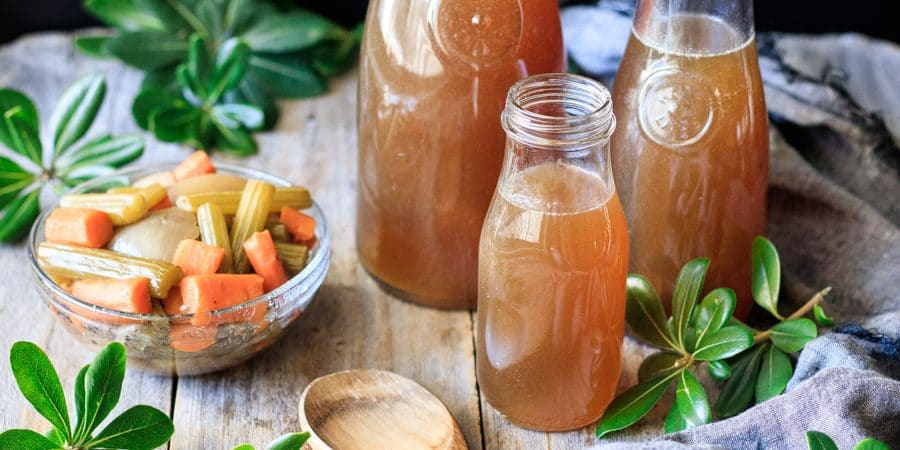 bottles of roasted turkey stock with vegetables