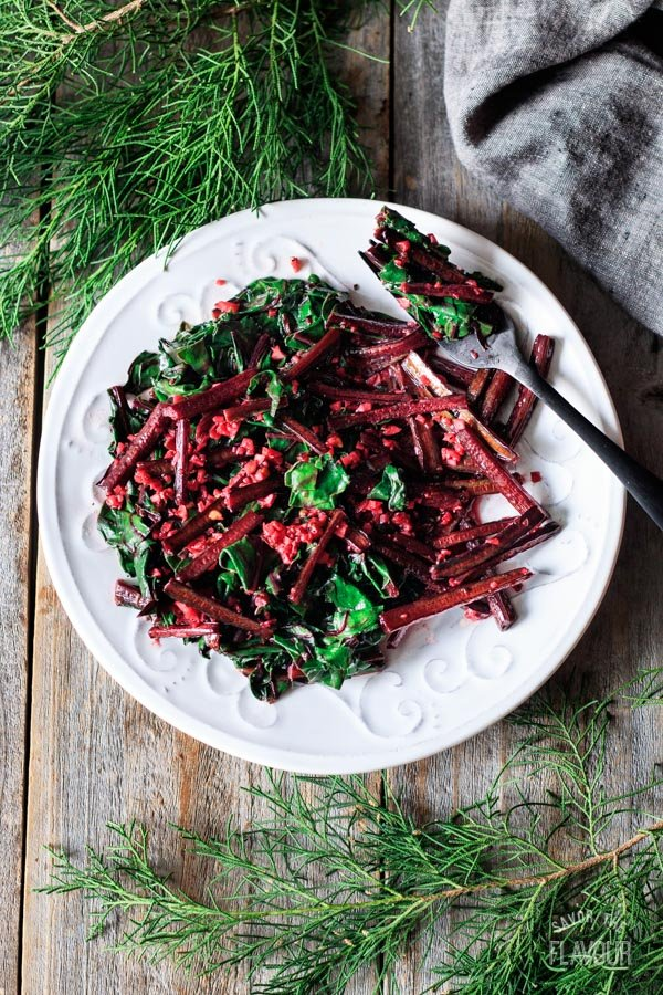 plate of sautéed beet greens with a fork