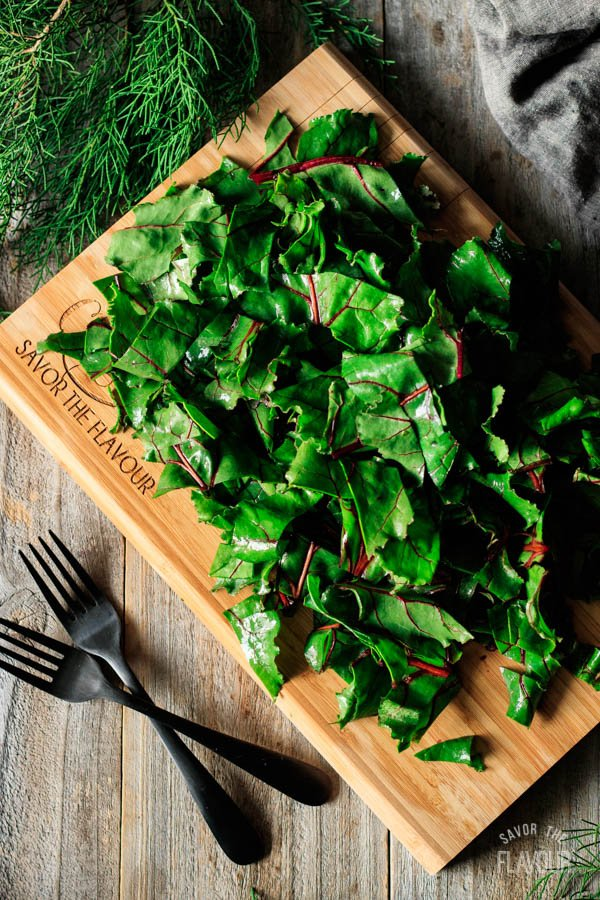 chopped beet greens on a cutting board
