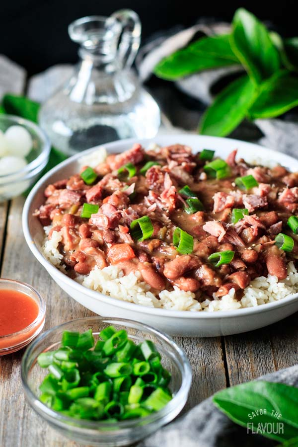 bowl of red beans and rice with toppings
