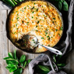 shepherd's pie in a skillet with spoon