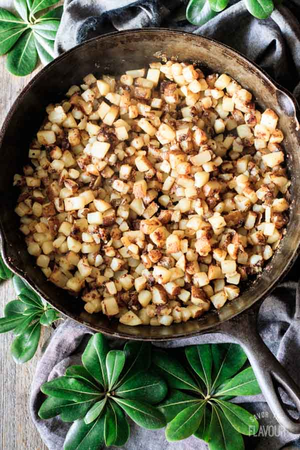 cooked potatoes in a cast iron skillet for breakfast hash