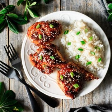 Asian chicken thighs on a plate