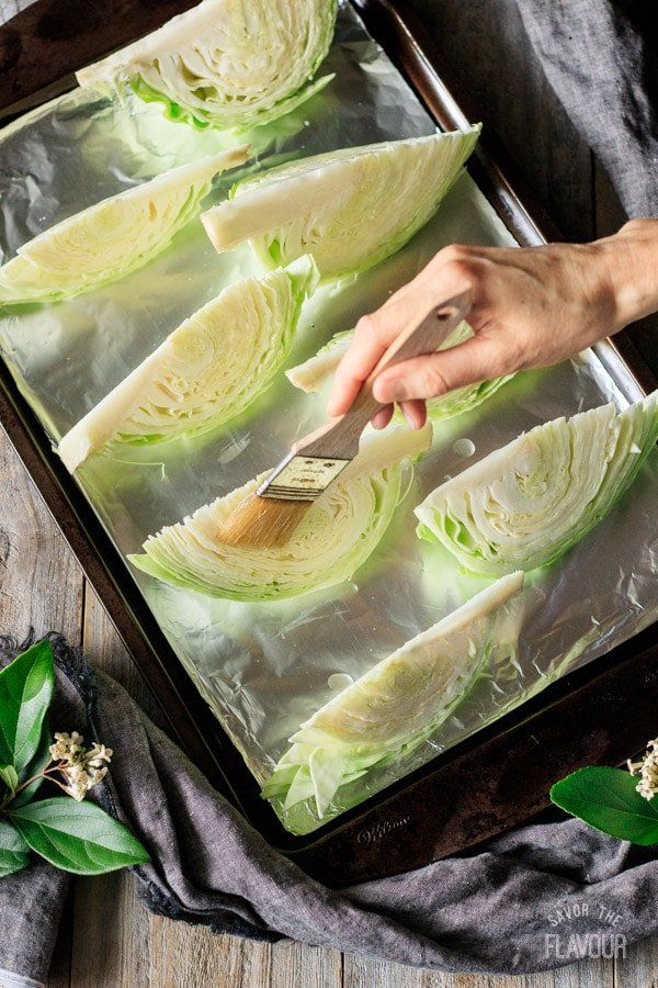 brushing oil on cabbage wedges