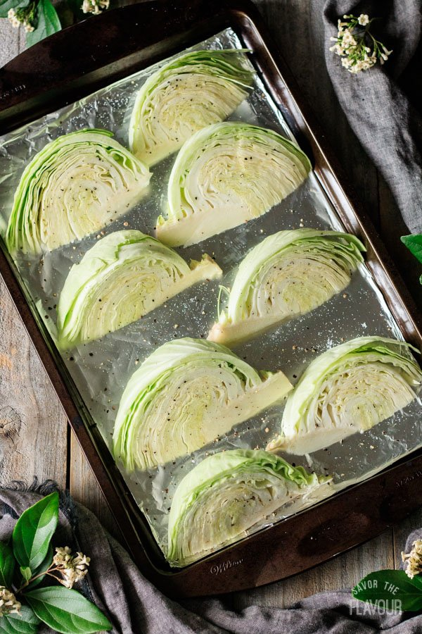 raw cabbage wedges on a tray