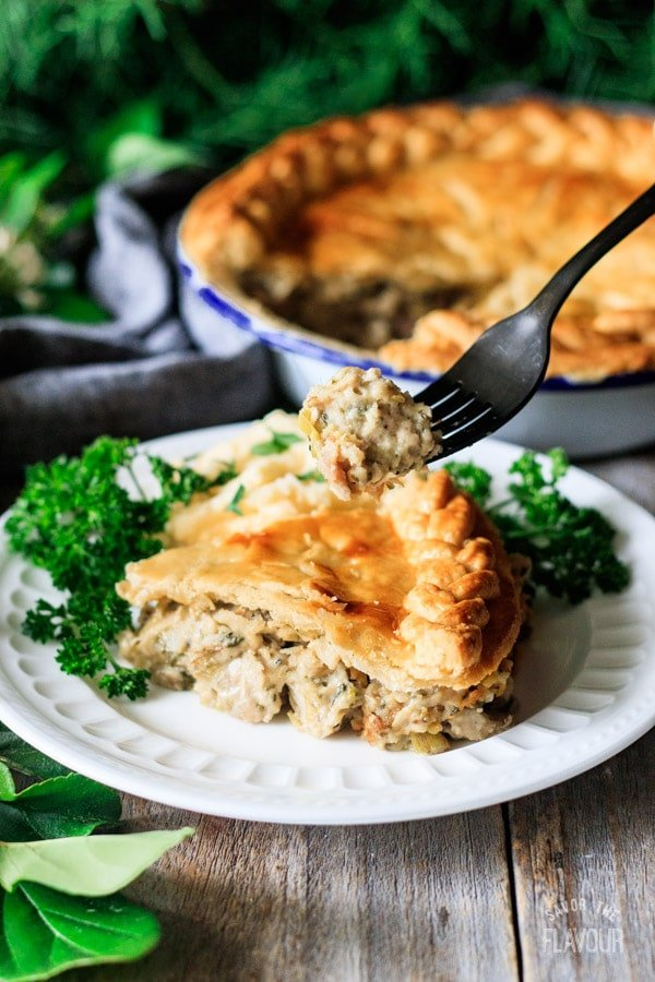 holding a forkful of chicken and leek pie