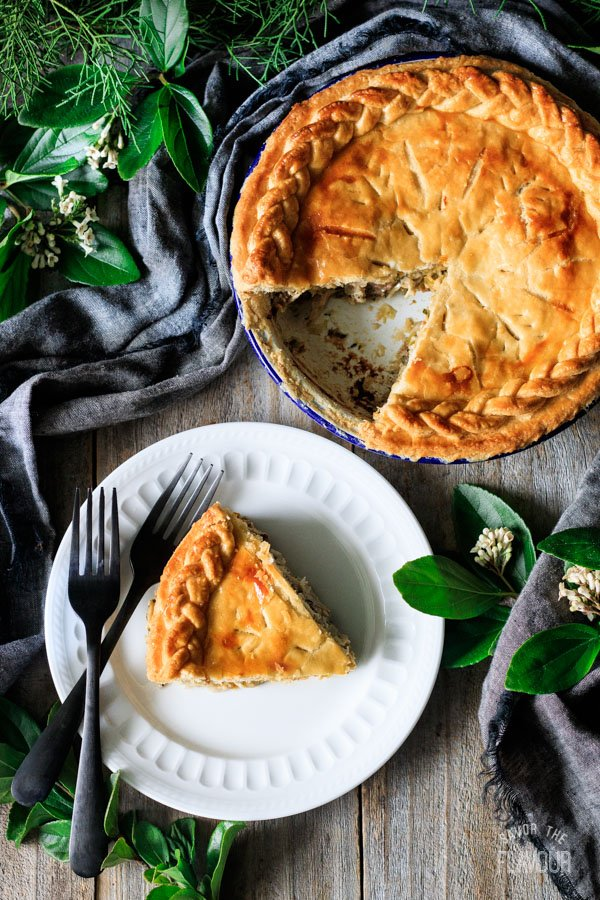 slice of chicken and leek pie on a plate with forks