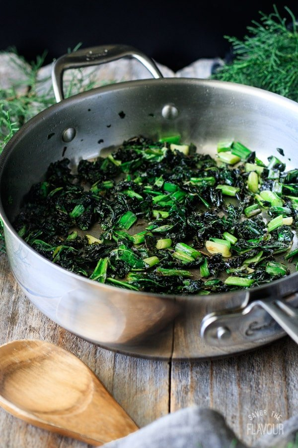 cooked kale and green onions for colcannon in a skillet