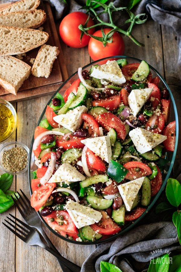 Greek salad with bread, tomatoes, olive oil, and oregano