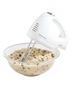 electric hand mixer with a bowl of chocolate chip cookie dough