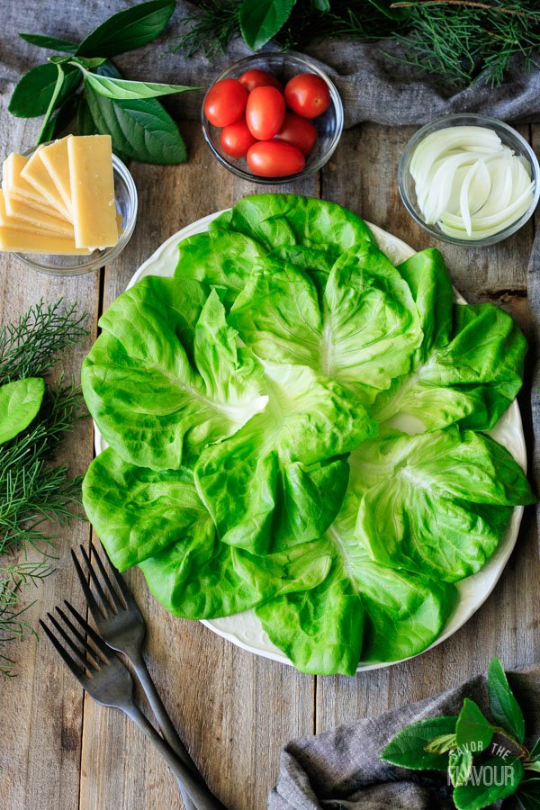 spreading Boston lettuce on a plate for Irish pub salad