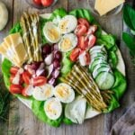 Irish pub salad on a plate with dressing