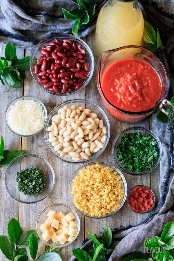 vegetables, broth, cheese, and herbs for pasta e fagioli soup