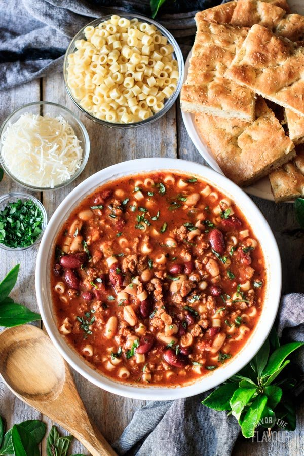 bowl of pasta e fagioli soup with rosemary focaccia