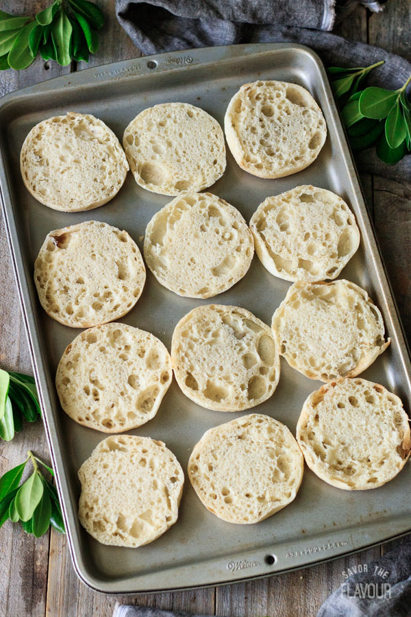 English muffins on a baking tray