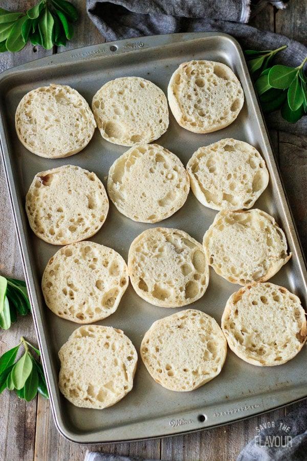 English muffins on a baking tray