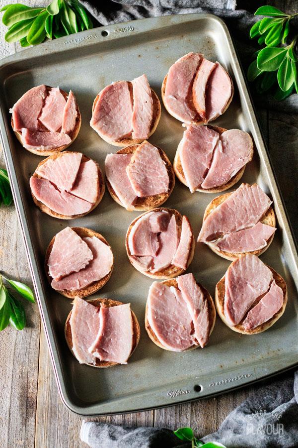 putting ham in breakfast sandwiches
