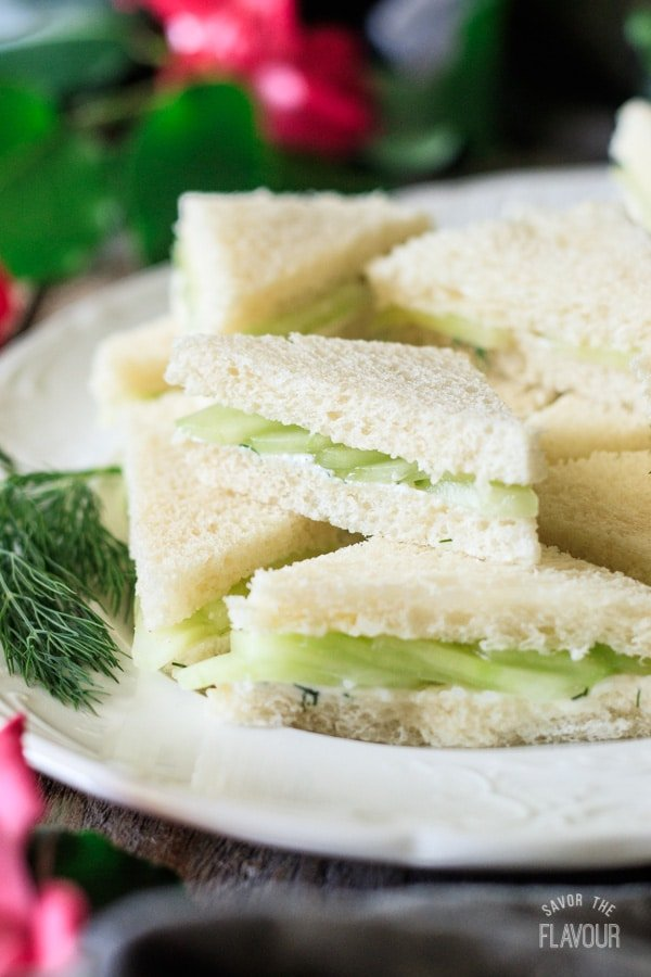 closeup of a cucumber sandwich on a platter