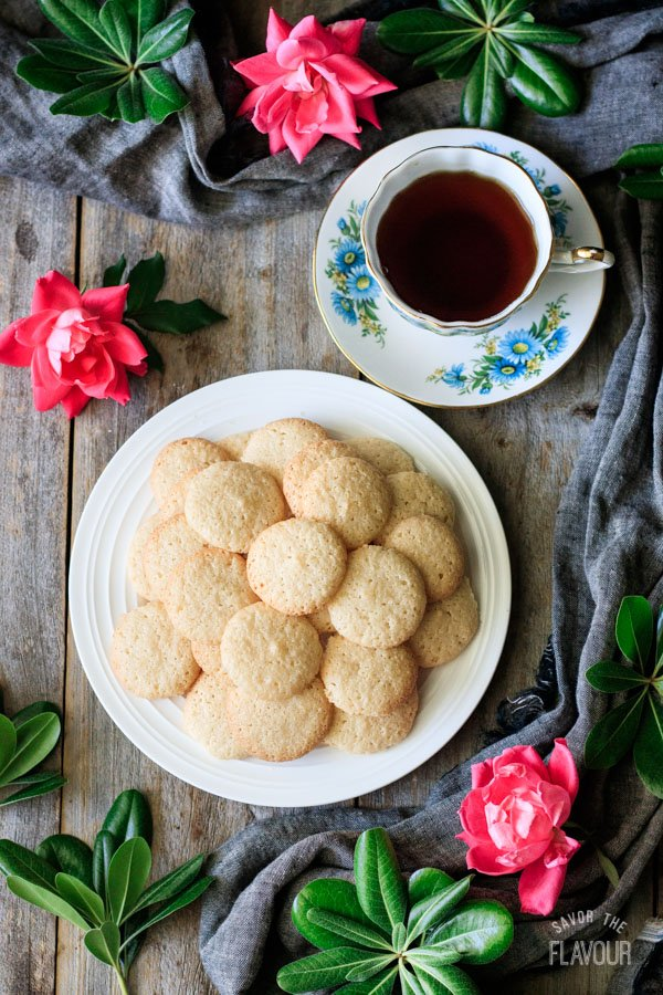 plate of ratafia biscuits with a cup of tea