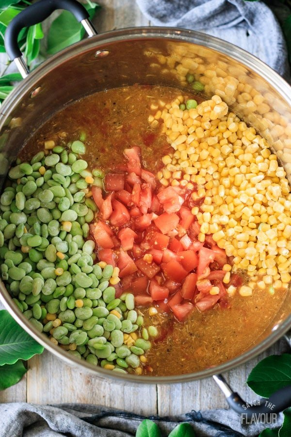 adding tomatoes, butter beans, and corn to Brunswick stew