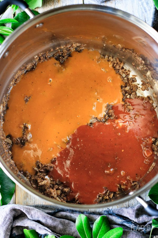 adding barbecue sauce to onions in a large pot