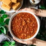 holding a bowl of Brunswick stew