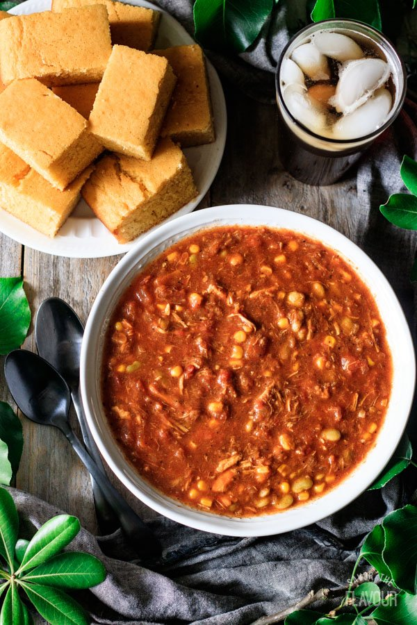 bowl of Brunswick stew with plate of cornbread