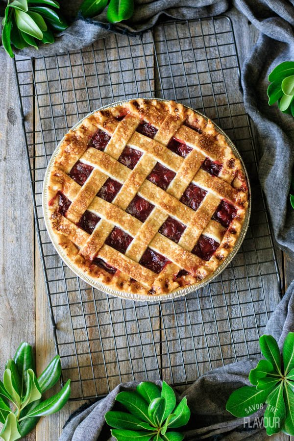baked cherry pie on a wire cooling rack