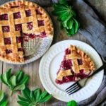 slice of cherry pie on a plate with a fork