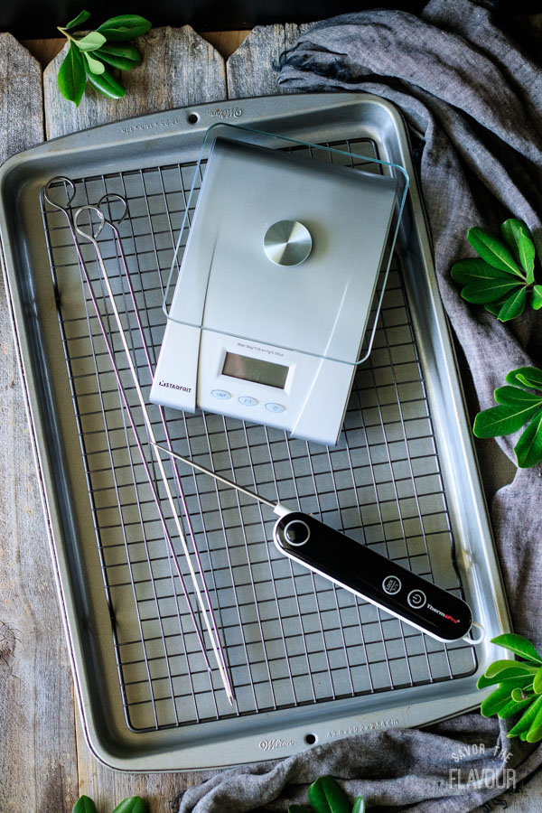 kitchen scale, cooling rack, thermometer, skewers, and cookie sheet