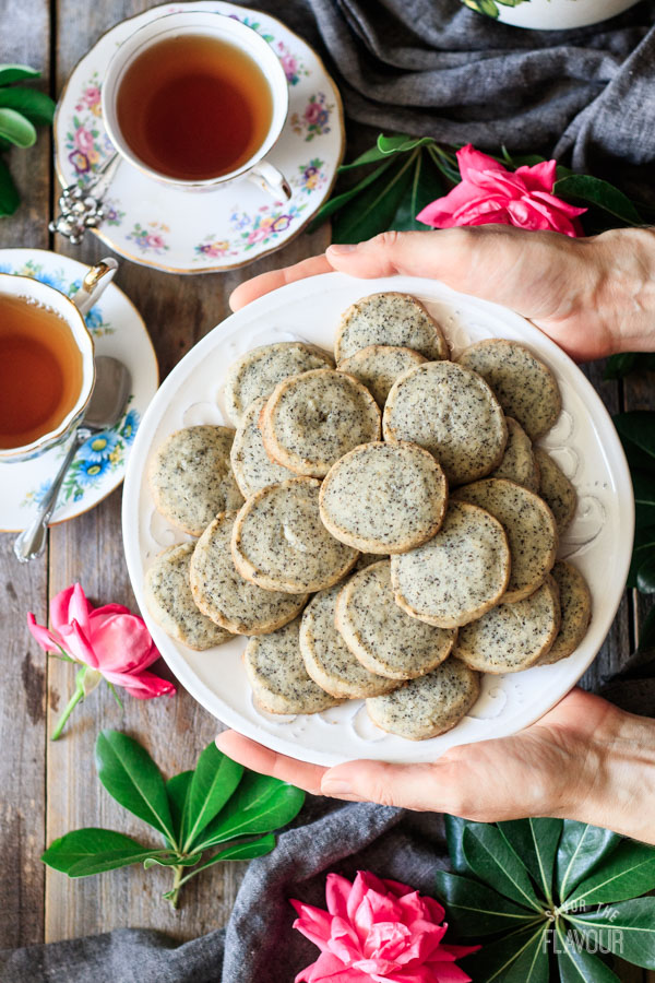 holding a plate of Earl Grey shortbread cookies