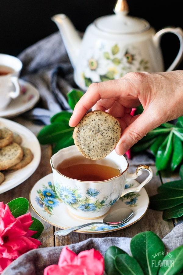 dunking an Earl Grey shortbread cookie into a cup of tea