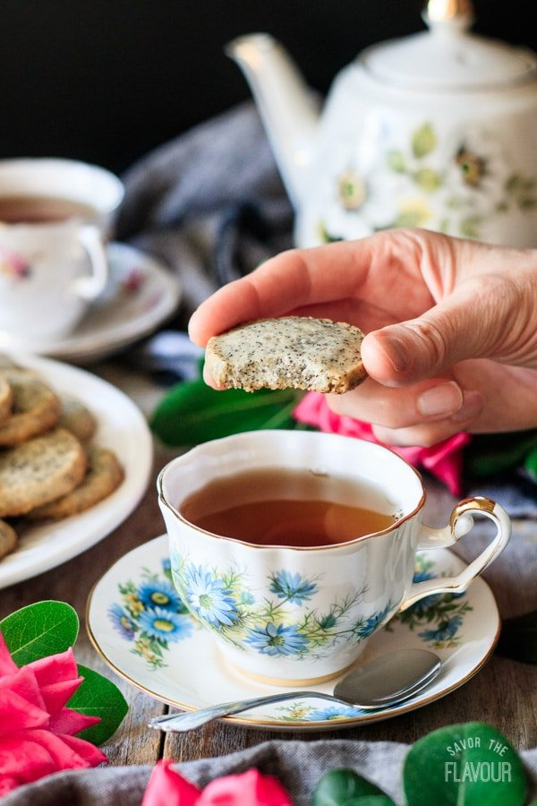 taking a bite of an Earl Grey shortbread cookie