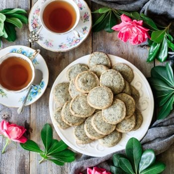 plate of Earl Grey shortbread cookies with two cups of tea