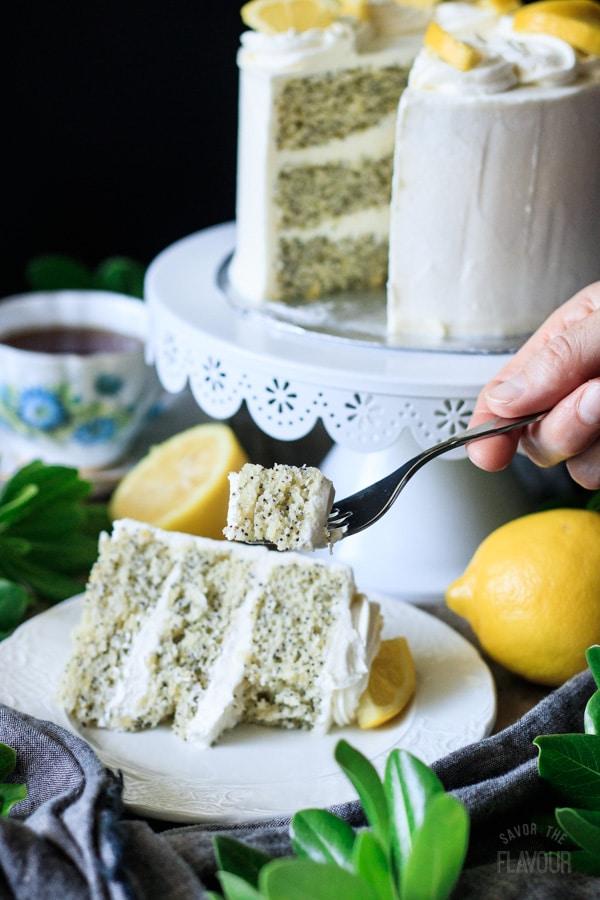 holding a forkful of lemon poppy seed cake
