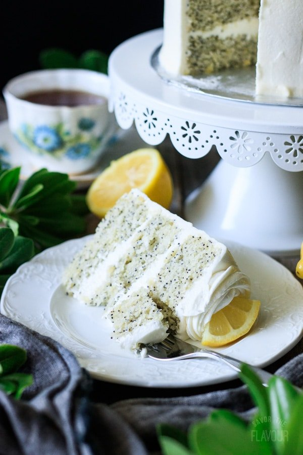 slice of lemon poppy seed cake with a fork