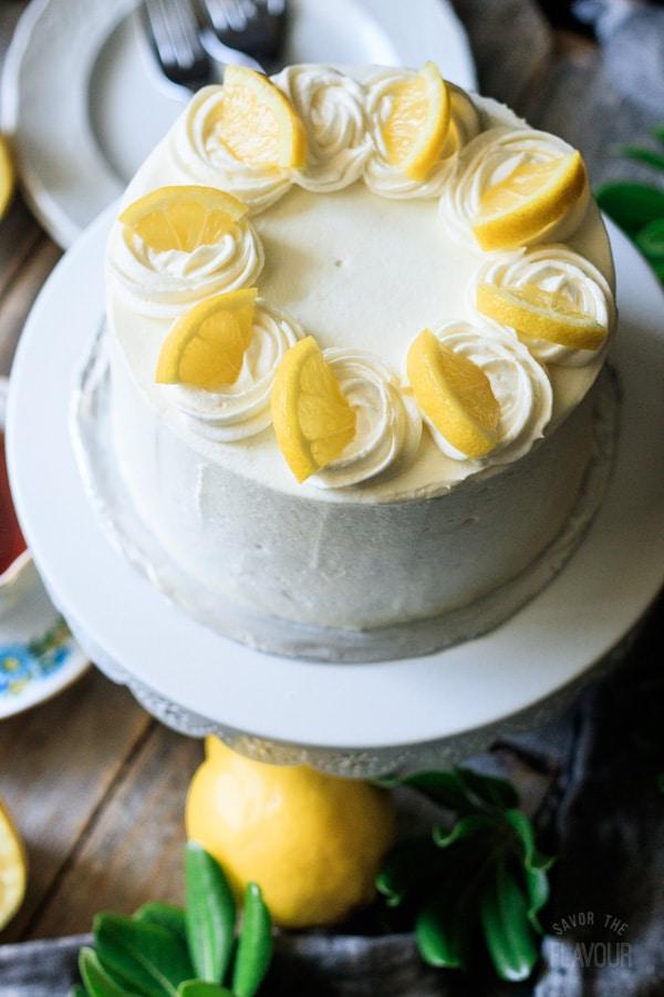 lemon poppy seed cake on a cake stand