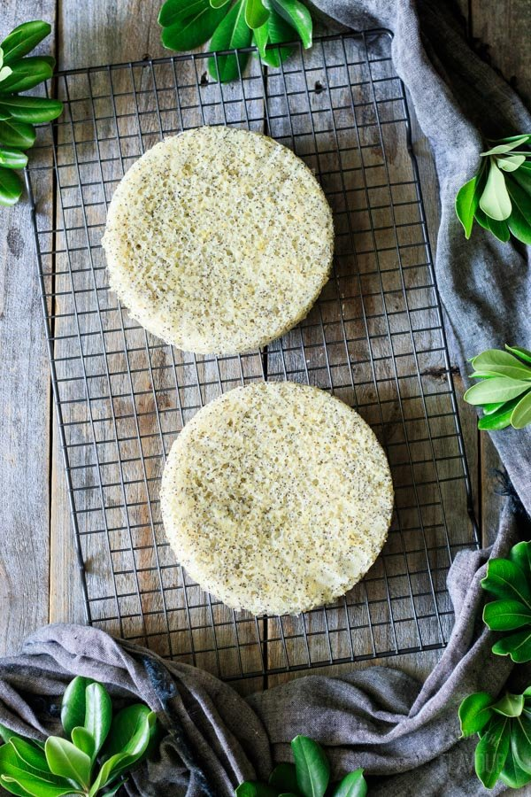 baked lemon poppy seed cakes on a cooling rack