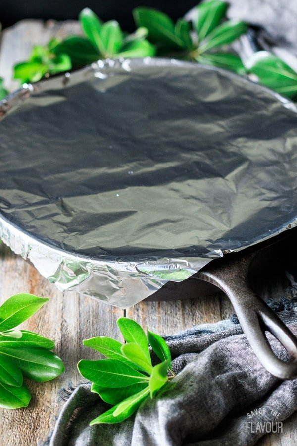covering cast iron skillet with foil