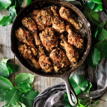 smothered chicken in a cast iron skillet