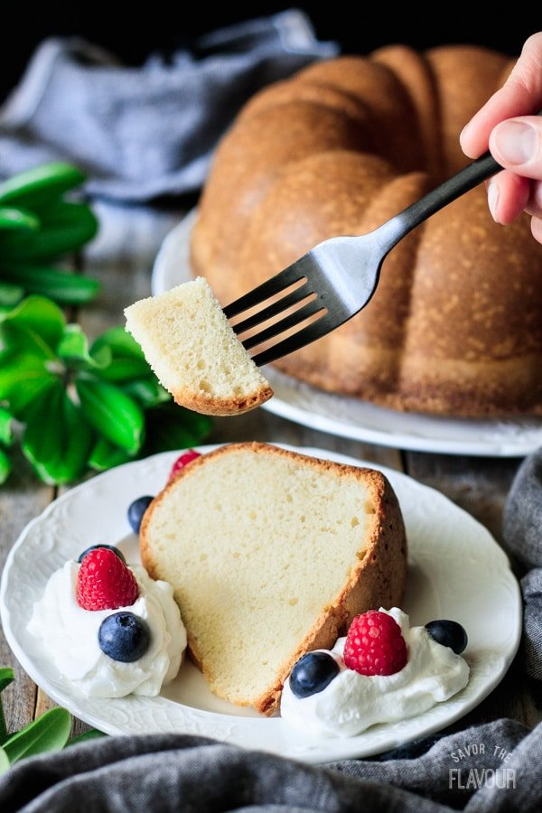 holding a forkful of pound cake