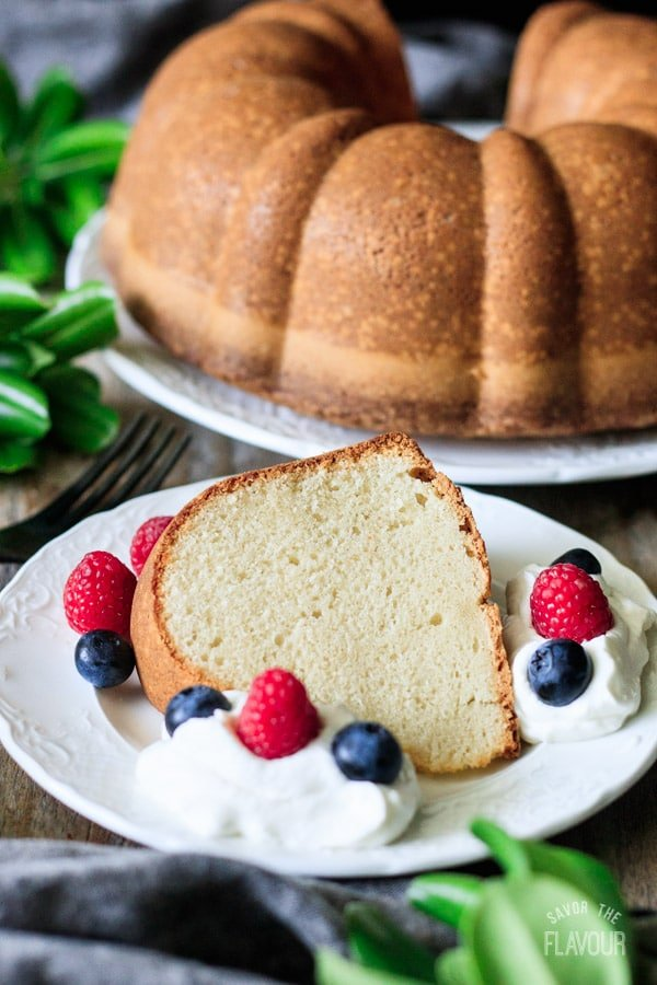 slice of sour cream pound cake with whipped cream