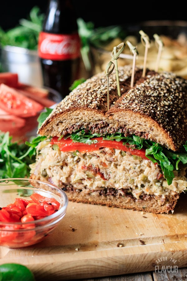 Sicilian tuna salad sandwich on a cutting board