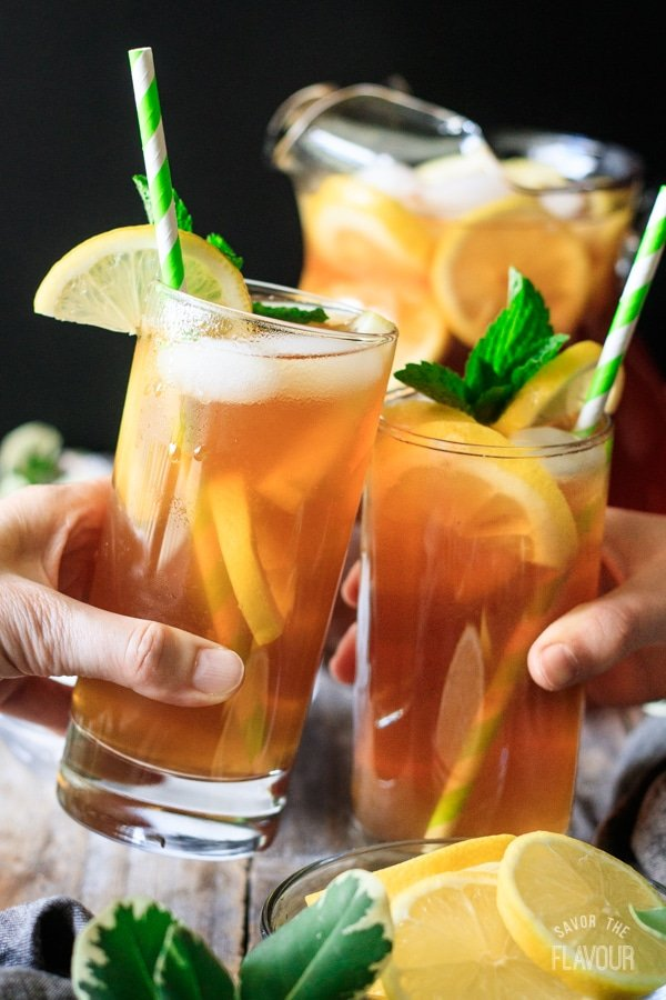 people doing a toast with two glasses of Arnold Palmer