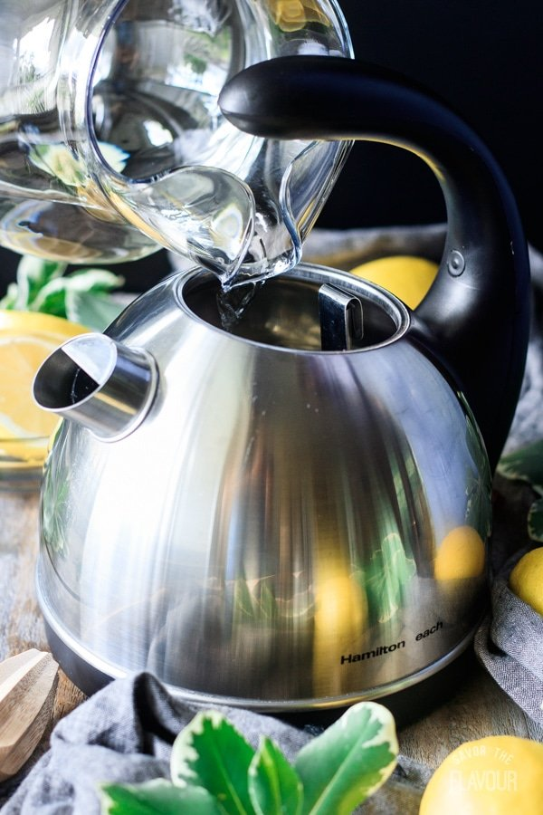 pouring water into an electric kettle