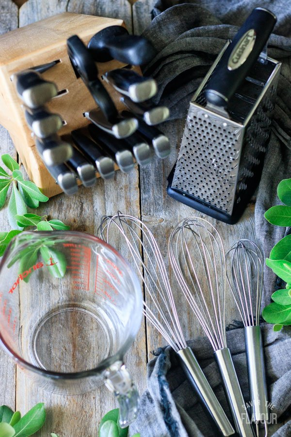 measuring cup, whisks, knife block, and box grater